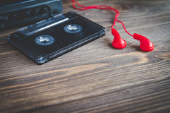 Audio cassette tape with player on a table Stock Photos
