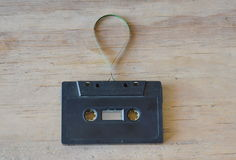Audio cassette tape recorder on wooden board Royalty Free Stock Photos