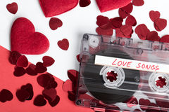 Audio cassette tape on red backgound with fabric heart Stock Images
