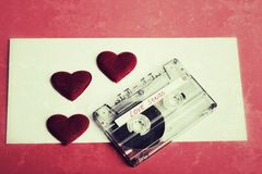Audio cassette tape on red backgound vintage tone color Royalty Free Stock Photo
