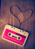 Audio cassette tape in the shape of heart. Stock Image