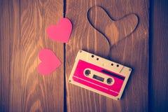 Audio cassette tape in the shape of heart. Stock Image