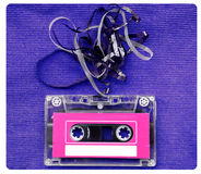 Audio cassette tape with subtracted out tape over blue textured Royalty Free Stock Images