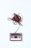 Audio cassette tape with subtracted out tape over blue textured wood board Stock Photography