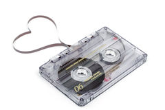 Audio cassette tape on white backgound. Film shaping heart