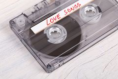 Audio cassette tape on wooden background Royalty Free Stock Image