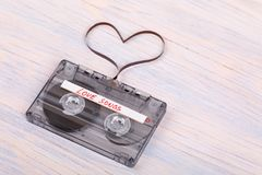 Audio cassette tape on wooden background. audio film shaping hea Stock Images