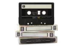 Audio cassette on three boxes. Isolated on white background Royalty Free Stock Photo