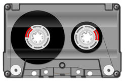 Audio cassette, transparent. Audio compact cassette, magnet tape, isolated on black, clipping path included royalty free illustration