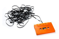 Audio Cassette. Vintage Orange audio Cassette isolated on white stock images