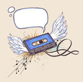Audio cassette and wings Stock Photo