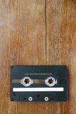 Audio cassette on wood Royalty Free Stock Images