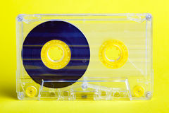 Audio cassette. On yellow background Royalty Free Stock Images