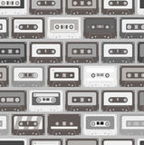 Audio cassettes seamless background. Vintage audio cassettes seamless background Royalty Free Stock Image