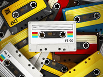 Audio cassettes. Spotlit retro audio cassettes stack Stock Image