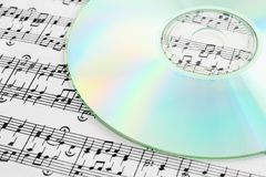 Audio CD and music notes Royalty Free Stock Photography
