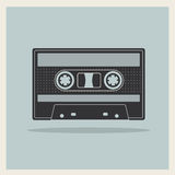 Audio  Compact Cassette Tape on Retro Background Stock Image