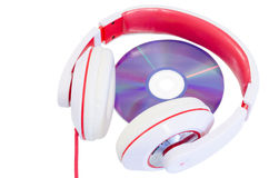 Audio compact disc and red white headphones Stock Image