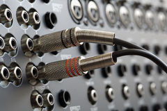 Audio connectors. On a sound mixer royalty free stock photos