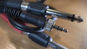 Audio connettori stereo con i cavi neri fotografia stock