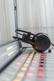 Audio consoleand and headphones. Audio console  and headphones in a radio studio Royalty Free Stock Photography