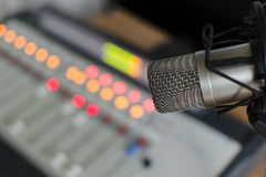 Audio consoleand and microphone. Audio console in and microphone a radio studio Royalty Free Stock Image