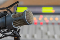 Audio consoleand and microphone. Audio console in and microphone a radio studio Stock Image