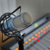 Audio consoleand and microphone. Audio console in and microphone a radio studio Stock Photos