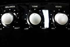 Audio Control. Close up of the balance, tone and echo control knobs on a karaoke machine royalty free stock photography