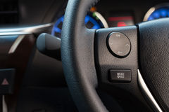 Audio control button on car steering wheel. Close up audio control button on car steering wheel stock photo
