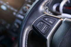 Audio control buttons on the steering wheel Royalty Free Stock Photography