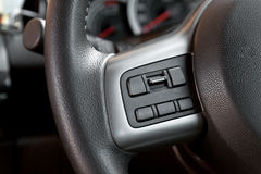 Audio control buttons on the steering wheel. Of car stock image