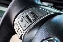 Audio control buttons on the steering wheel of a modern car. Audio control buttons on the steering wheel of modern car royalty free stock photos