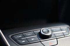 Audio control in a car with a black background for copy space. Audio equipment on modern car dashboard background at night. Selective focus stock images