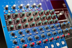 Audio control console. An audio control console, closeup, narrow focus stock photo