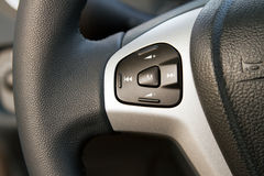 Audio control knob on steering wheel Stock Photo