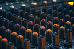 Audio controller. Color potmeters on audio controller Royalty Free Stock Photo