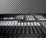 Audio Controller equipment with many bar level. Sound proof Acoustic black gray foam absorbing, pyramid style padding layer panel for voice recording studio royalty free stock images