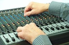 Audio device. Hand mixing of sound in electronic device Stock Photo