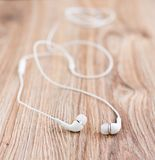 Audio earphones on a table Royalty Free Stock Images