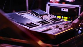 Audio Engineer in front of audio mixing console during show stock video