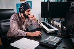 Audio engineer in headphones work in studio Stock Photo