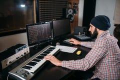 Audio engineer work with musical keyboard Stock Photo