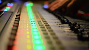 Audio Engineer Working on mixer equilizer Stock Photo