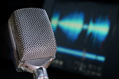 Audio Engineering. Microphone with waveform and audio computer background stock image