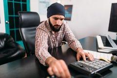 Audio engineering, man work with musical keyboard Stock Image
