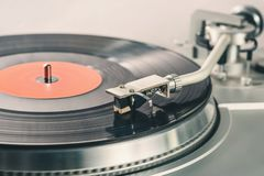 Vintage record player. Needle head and disc. Audio equipment for club party.Vintage turntables for concert.Retro audio setup for disc jockey to play music in stock image