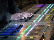 The audio equipment, control panel of digital studio mixer. During a concert at night stock photos