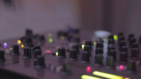 Audio equipment. DJ pushing mixing console buttons, mixing. Party atmosphere stock video