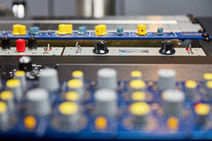 Audio hardware with switches and knobs Stock Images